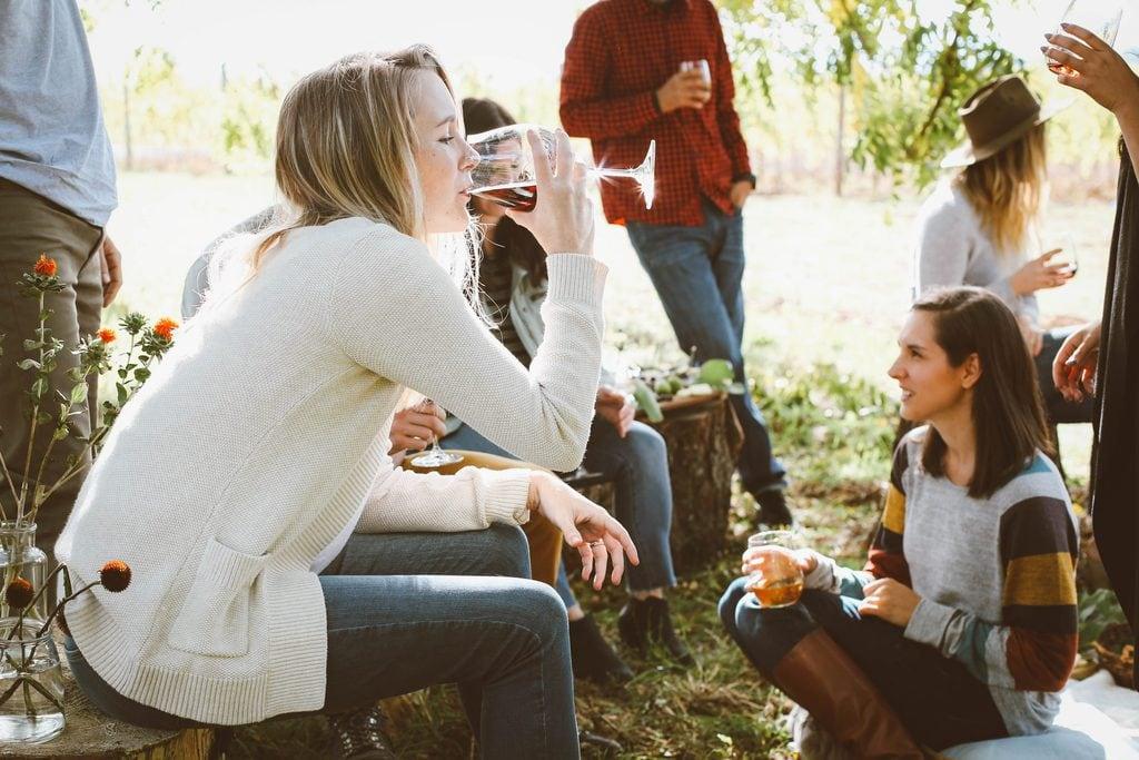 women drinking vegan wine